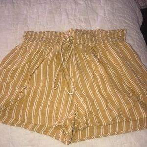 yellow and white striped flowy shorts